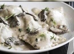Ricotta and Spinach Ravioli in creamy mushroom sauce